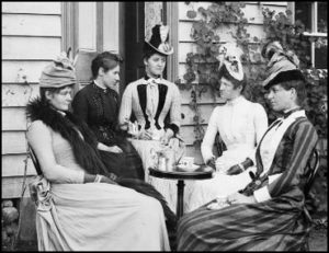 Victorian-era ladies sitting around a table