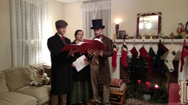 Dickens Carolers visit homes on the Wassail Tour